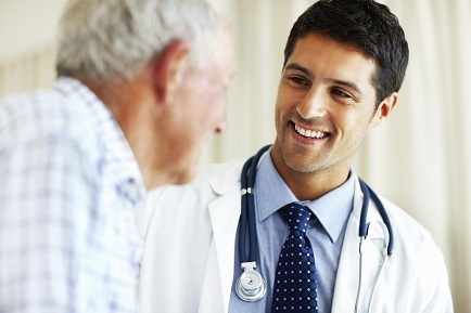 Portrait of handsome doctor talking with senior patient